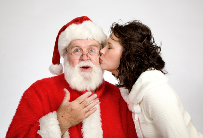 Woman Kissing Santa Claus